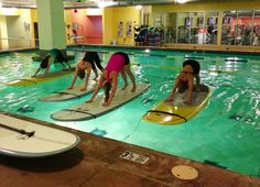 Paddle board yoga. Looks like this would take incredible balance.