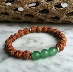 Release Negativity bracelet by Wanderbird. This bracelet is made with rudraksha beads and jade stones. Jade Stone, Jade Beads, Heart Chakra, Traveling By Yourself, Healing, Beaded Bracelets, Gemstones, Trending Outfits, Unique Jewelry
