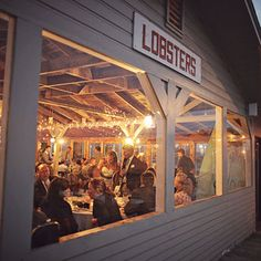 Shot of reception from the outside | Evening wedding reception in coastal Maine