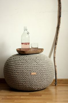 Natural Flax Linen Pouf, Ottoman, (19,7 inch x 15,7 inch). - Size: diameter 50 cm (19,68 inch), heigh 40 cm (15,74 inch), handmade in from natural non coloured flax linen cord, linen filling bag filled with polystyrene (styrofoam) balls. Because of unique flax cord texture, pouf has rough, rustic but very unique look. Linen cord is very durable, also safe for kids, hypo-allergenic.This poof will be perfect for people who prefer unique, green materials in their home. Linen is one of the…