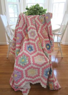 Vintage Quilt - Grandmother's Flower Garden.  My mom has her moms quilt like this that she made.