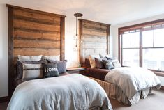 Board and batten headboard bedroom rustic with floating night table windows