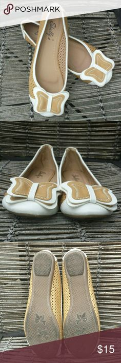 Super Cute Tan and White Butterfly Flats Tan and white abstract butterfly shoes. Worn one time. Slight discoloration on the back of one shoe. Less than 1/8th of an inch. Unnoticeable unless inspecting closely. Shullys Shoes Flats & Loafers
