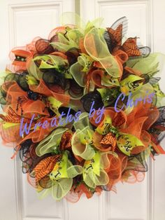 """Halloween!!  Wreaths by Chris https://www.etsy.com/shop/WreathsByChris A new style of deco mesh wreath--ruffles! There are almost 30 yards of lime, orange and black deco mesh in this wreath! It's accented by a glammed out spider and 6 yards of lime Trick or Treat, orange Cob-web and dot/stripe ribbons . It's beautiful and full-- about 24"""" across and a thick 10"""" deep. Trick or Treat ribbon, 10"""" mesh and ruffle wreath tutorial all from http://www.trendytree.com #trendytree #halloween"""
