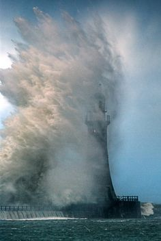lighthouse-I used to have a poster similar to this-freightening how powerful the ocean tide can be