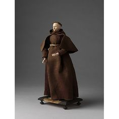 Capuchin Friar    Object:  Ecclesiastical figure    Place of origin:  France (possibly, made)   germany (possibly, made)   Netherlands (possibly, made)    Date:  18th century (made)    Artist/Maker:  Unknown (production)    Materials and Techniques:  Figure made of tow and wax, dressed in linen and woollen materials.    Credit Line:  Given by Mr. G. Smith    Museum number:  1212:10-1905    Gallery location:  In Storage