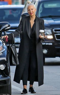 On full display: Singer Sia Furler, 40, put aside her famous face-shielding wig as she stepped out to grab a coffee in LA on Friday