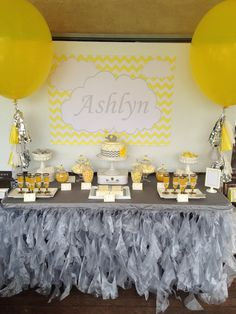 Use a yellow and gray color scheme for a gender neutral baby shower