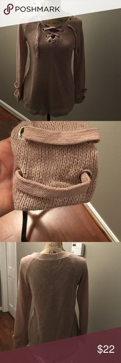 Fine knit shoelace sweater New without tag, fine knot sweater marked large but fits more like a S/M. Cute shoelace detail on sleeves not branded Sweaters V-Necks