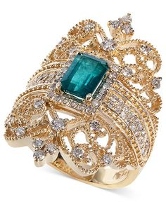 Brasilica by EFFY Emerald and Diamond Ring. As intricate as a piece of artwork, this exquisite ring features an ornate, scrolling design. Set in 14k gold, it shines with the addition of an emerald-cut emerald (9/10 ct. t.w.) and round-cut diamonds (3/4 ct. t.w.). $7,000
