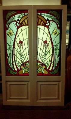 newglassworks:  These are a pair of french doors with some art nouveau stained glass panels I made. The design is based upon an original design from the time, I had to alter it slightly to fit this style of door. These are currently listed on ebay if anybody likes them!!!