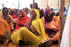 Women and their children watch the Darfur Drama actors perform at El Srief (North Darfur). This peacebuilding initiative is organized in part by UNDP, the African Union, the UN's Mission in Sudan and a number of other international and local partners.  www.undp.org  Photo: UN/Albert Gonzalez Farran