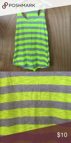 Workout striped tank in neon yellow & grey Workout striped tank in neon yellow & heathered grey. From forever 21 worn a couple of times. Perfect for outside at night workouts Forever 21 Tops Tank Tops