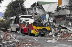 Building rubble and crushed buses line Colombo Street, a main route through Christchurch, two days after the quake of Feb. Happy Anniversary Clip Art, New Zealand Earthquake, Nz History, Broken City, New Zealand Cities, Christchurch New Zealand, 2nd City, Seattle Times