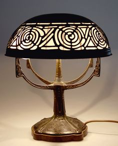 Gustav Gurschner, Vienna. Table light, c1905. H. 37 cm; D. 32.7 cm. Made by K&K Kunsterzgiesserei Vienna. Bronze, dark green patina. Marked: GURSCHNER, K&K KUNSTERZGIESSEREI WIEN, 763.