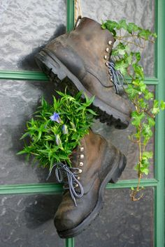 Love this idea:   Old Boot Planters. My cat is obsessed with my brother's boots and loves to sniff and scratch them. He's getting rid of them so I'm snatching them up to plant cat nip and cat grass in for my kitties :)