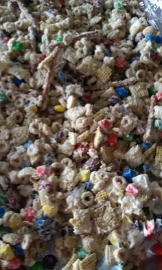 """""""Christmas Crack"""" - white chocolate, corn and rice chex, cheerios, mixed nuts, m and pretzels.  Easy and WAY addictive, plus this recipe makes a lot so there's plenty to share!"""