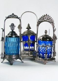 Three Blue Glass Pickle Caster Sets including unmarked caster with etched cobalt glass canister, with lid and tongs, . Antique Dishes, Antique Glassware, Bottles And Jars, Glass Bottles, Perfume Bottles, Cobalt Glass, Cobalt Blue, Murano, Himmelblau