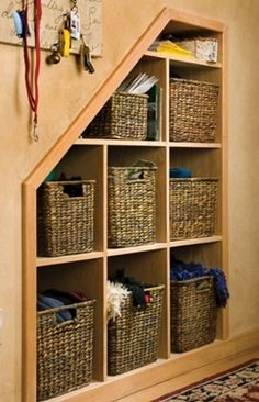 Cool cubbies: open shelves with baskets - 12 Creative Storage Ideas for Under the Stairs - Cabin Life Magazine Stairway Storage, Basement Storage, Basement Stairs, Storage Stairs, Cozy Basement, Basement Ideas, Playroom Ideas, Under Stair Storage, Dark Basement