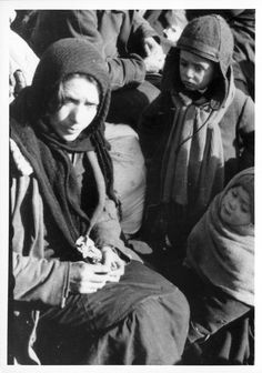 Lubny, Ukraine, A woman and children waiting at the assembly point before being murdered, 16/10/1941. The Jews of Lubny and the surrounding area were ordered to gather with their personal belongings on 16/10/1941. They were led to a site out of town and were murdered on the same day.