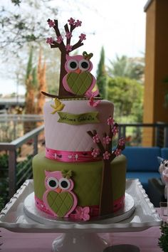 Owl cake; owls and tree made with 50/50 fondant and gumpaste. Matching cookies and cake pops too.