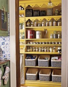 I like these baskets for pantry organization - how they're lower in front so you can see what's there. Also the whole thing is super cute. The yellow makes me happy.