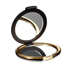 Golden mirror with rubberized black finish. Perfect size for your handbag or cosmetic case, touch up your make-up anytime. Comes with two mirrors, one regular size and one magnifying. Golden Mirror, Magnifying Mirror, Cosmetic Case, Beauty Shop, Cartier Love Bracelet, Black Rubber, Makeup Yourself, Gold Rings, Fragrance