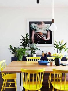 Lively lemon dining chairs add a kick to this dining room. If this is too much, consider replacing just one or two of your dining chairs with a bright color.
