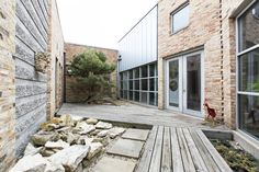 A gallery of images of Parchment Studio showing the main house,kitchen,client room,production,east and west courtyard