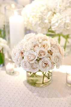 All-rose #centerpiece |   Photography: Aaron Delesie Photographer - aarondelesie.com Event Planning: Birch Design Studio - birchdesignstudio.com Floral Design: Kehoe Designs - kehoedesigns.com/  View entire slideshow: Runway to Real Wedding: Classic on http://www.stylemepretty.com/collection/235/