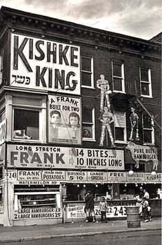 "The graphic of a boy and girl chomping on the same 10 each long frank is fabulous. ""A Frank Built For Two.""  Kishke King,  taken in 1953 on Pitkin Avenue, Brownsville. It is from the series: ""An Era Past: Photographs of Brownsville and East New York, Brooklyn"" by Artist: N. Jay Jaffee, American, 1921-1999"
