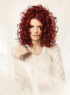 loose spiral perm with ringlets not sure if I am seduced by the curls or the color!!