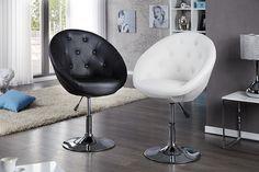 """Eleganter Drehsessel """"Couture"""" mit verchromtem Tulpenfuss und einer Sitzschale aus hochwertigem Kunstleder mit Zierköpfen. Durch den Hebelmechanismus lässt sich dieses außergewöhnliche Designobjekt ganz einfach in der Höhe verstellen, sodass Sie den Sessel auch als Büro- oder Esszimmerstuhl nutzen können. Seine enorme Funktionalität macht den Drehsessel zum dekorativen und alltagstauglichen Loungeklassiker."""