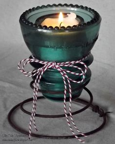 upcyled glass insulators as candle holders - The Olde Farmhouse on Windmill Hill
