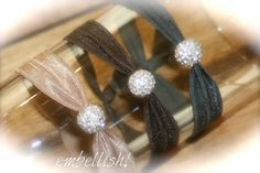 This listing is for one fabulous hair tie with a 100% real crystal pave bead.    If you love our hair ties, you are going to flip over these! Take your 'do from casual to classy in seconds with these ties!     These ties are easy on your hair and eliminate the breakage that normal ponytail holders usually do to your hair! Super comfortable!!!!    This isn't the fake stuff, it's 100% REAL crystal!!!!!    Tons of colors available!  $6.25 each