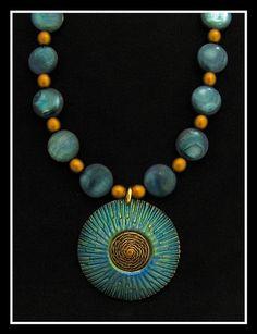 Amazingly beautiful polymer clay jewelry by Helen Breil.  http://www.helenbreil.com