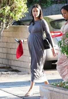 Mom to be! Pregnant Zoe wore a chic grey frock which cinched above her belly