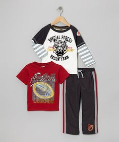 Aside from being fashionably handy, this darling set offers little ones a healthy dose of comfort and convenience. As if the stripe, easy-on pants weren't enough, the set also boasts a lively layered tee and sporty football short-sleeve tee for extra style and versatility.