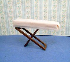 Complete your dollhouse kitchen or laundry room with this vintage wood folding ironing board.  Padded cloth top  4 1/4 inches long 2 3/4 inches high for the scale dollhouse