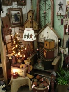 country and primitive decor my favorite! I like the boxes--I bet I could make some out of cereal boxes (or paper mache ones from the store) and paint them!