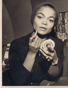 Eartha Kitt and applying her lipstick
