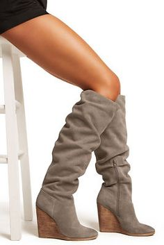 db0046d1b5d Luxuriously soft suede frames this sexy slouch boot designed with a stylish  almond toe and stacked