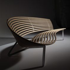 Leda Seat. Its seductive curves are created by a series of Plywood hoops on laser-cut anodised aluminium legs that offer a choice of comfortable seating positions.