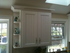 Angled corner filler on end of peninsula and decorative door ...
