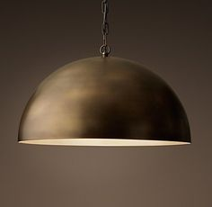 RH's Antiqued Metal Dome Pendant:Inspired by an industrial pipe section, our metal-shaded pendant is crafted of a seamless wrap of steel with an aged, burnished finish.