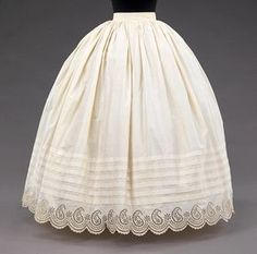 1855–65 Petticoat. The motif of the eyelet embroidery illustrates the enduring fascination with the paisley motif. The boteh, or paisley, originated in Persia and was disseminated to the Western world through Indian shawls which were at the height of popularity at this time. As was customary, the name of the owner was handwritten in ink for purposes of indentifying ownership for laundering.