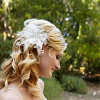 Her wavy blonde locks look extra romantic with a floral headpiece.
