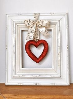 Ah, removing the Christmas bulbs and hanging some Valentine's looking decor instead. Great idea for using that frame again!
