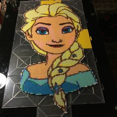 Disney Elsa - Frozen perler beads by caitlondiescrafts / Pattern: http://www.pinterest.com/pin/374291419006268579/