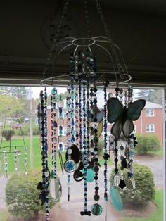 suncatcher/windchime chandelier out of old jewelery and do-dads from Goodwill